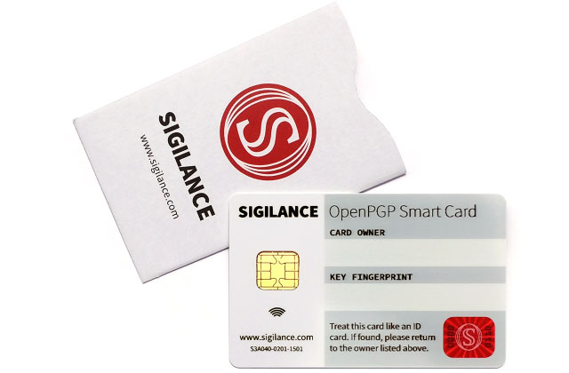 A product shot of the SIGILANCE OpenPGP Smart Card, sitting on top of an RFID-blocking sleeve for the same.